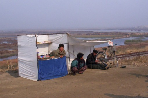A snack kiosk and bicycle repairing station in Ryonggang county near Nampo